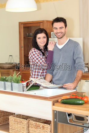smiling woman and man in kitchen