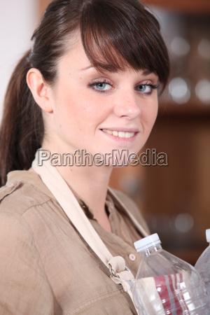 girl holding plastic bottles