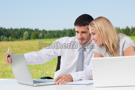 business colleagues in sunny nature with
