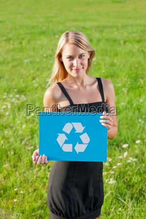 green energy young businesswoman hold recycle