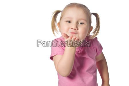 little girl sends kiss