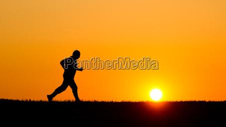 jogging direction senior evening sky