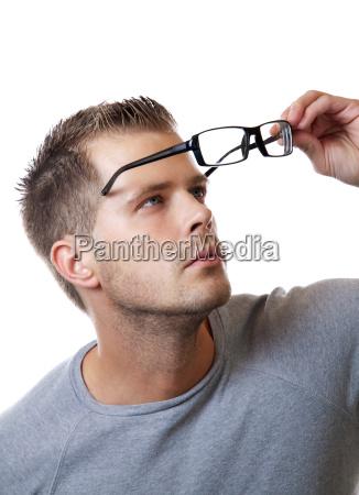 putting on glasses