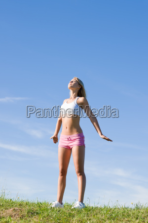 stretching young sportive woman meadows sunny