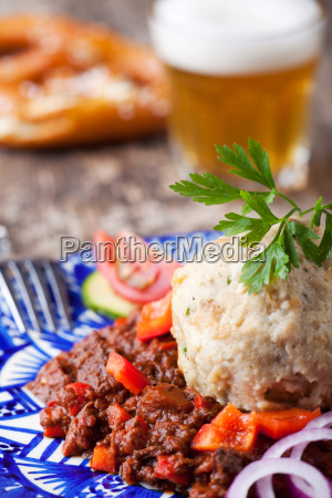 goulash with dumpling on a blue