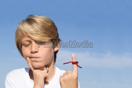 forgetful kid with string tied on