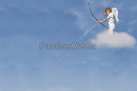cupid firing arrow from cloud for