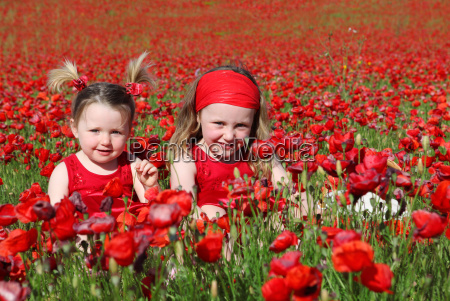 girls young summer playing meadow happy