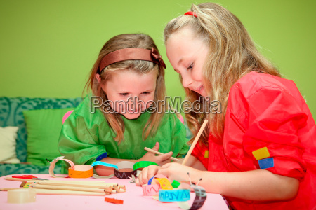 happy children playing drawing and making