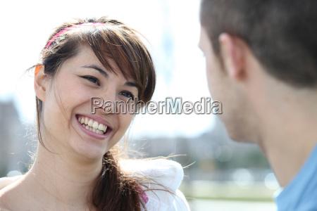 smiling woman talking to a man