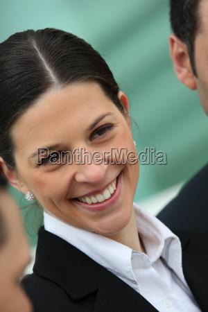 smiling woman wearing suit