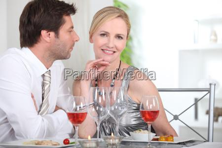 couple in restaurant having romantic meal