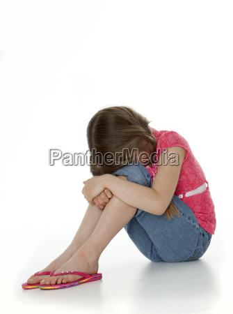 upset little girl on white