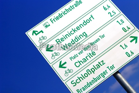 street sign and signpost in berlin