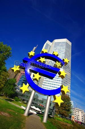 euro symbol with skyscraper on the