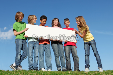 group of diverse children holding blank