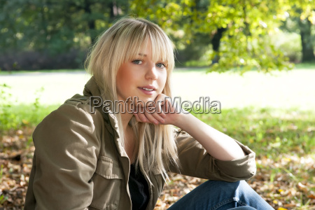 young woman sitting in the park