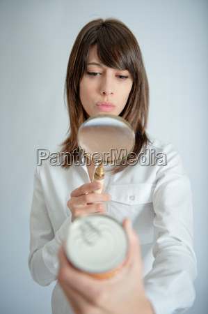 woman scrutinizing nutrition label