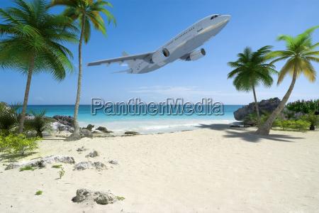 airplane and tropical beach