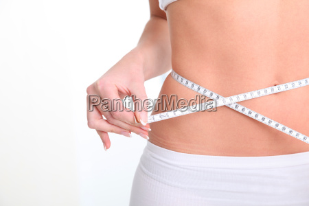 slim womans waist and measure tape