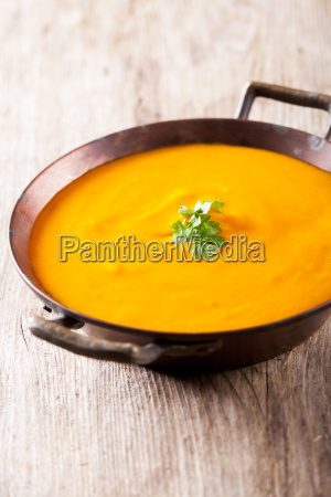 pumpkin soup in a copper pot