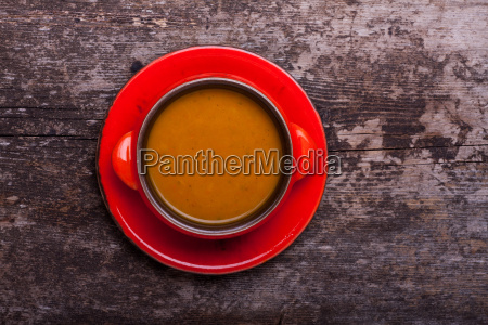 pumpkin soup on wooden board