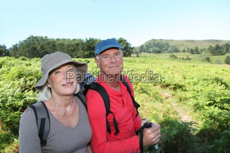 portrait of happy senior couple hiking