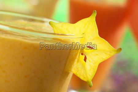 carambola garnish on mango juice