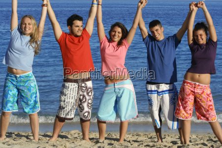 mixed race group of teens on