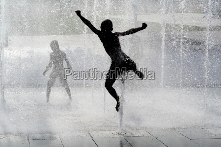 happy wet summer kids playing in