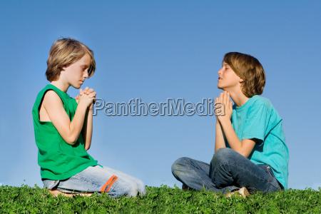 christian children praying outdoors at prayer