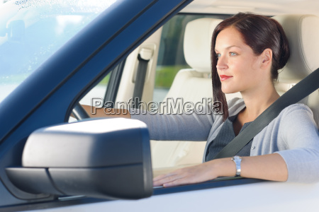 attractive businesswoman drive luxury car