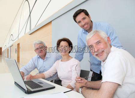 group of senior people attending job