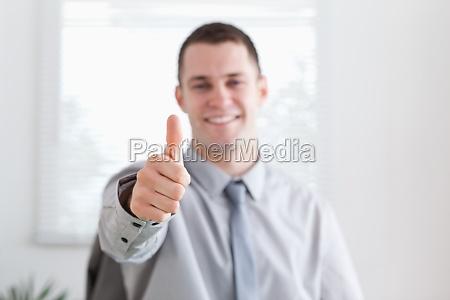 smiling businessman approves