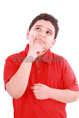 child with a pensive expression looking