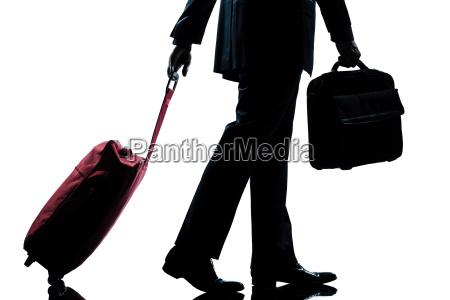 business traveler man walking with handbag