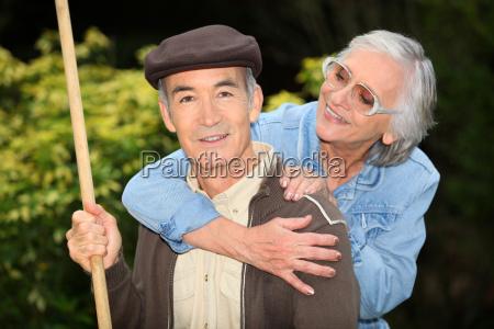 senior couple playing outdoors
