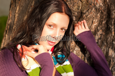 winter young woman in romantic sunset