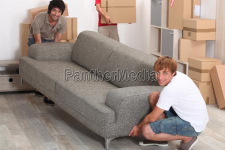men lifting sofa