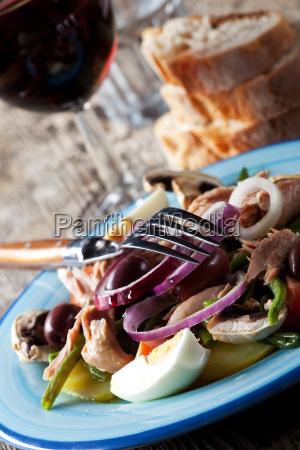 salad nicoise with wine
