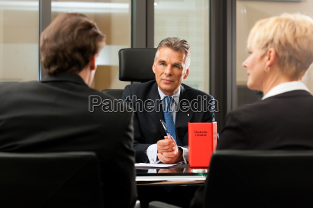 lawyer or notary with clients in