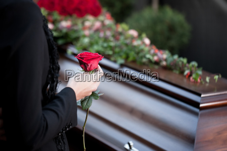 woman at funeral with coffin
