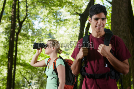 young man and woman hiking in