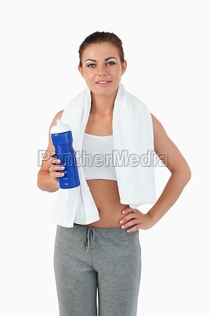 sportswoman with bottle