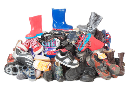 pile of child shoes isolated