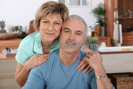 mature couple sitting in the kitchen