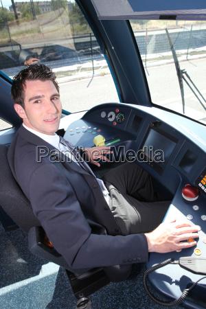 young man driving tram