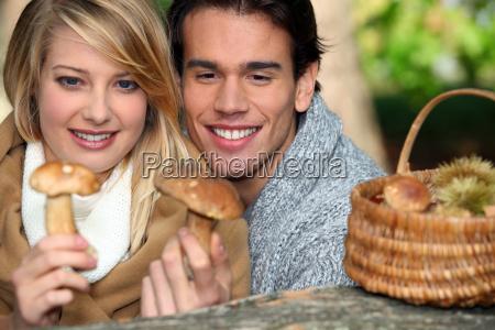 couple looking at mushrooms