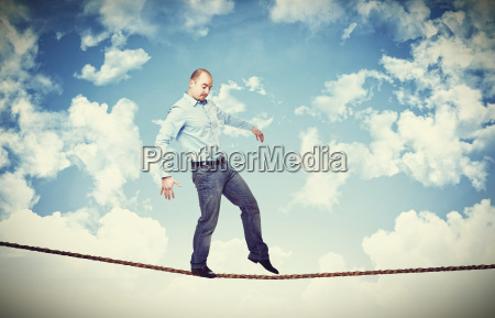 man walk on rope