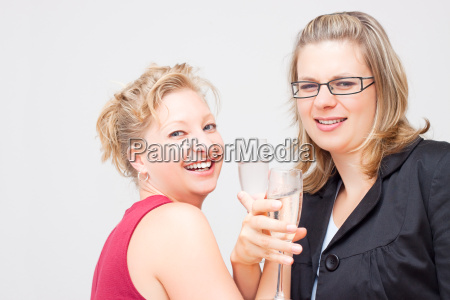 two women celebrate success